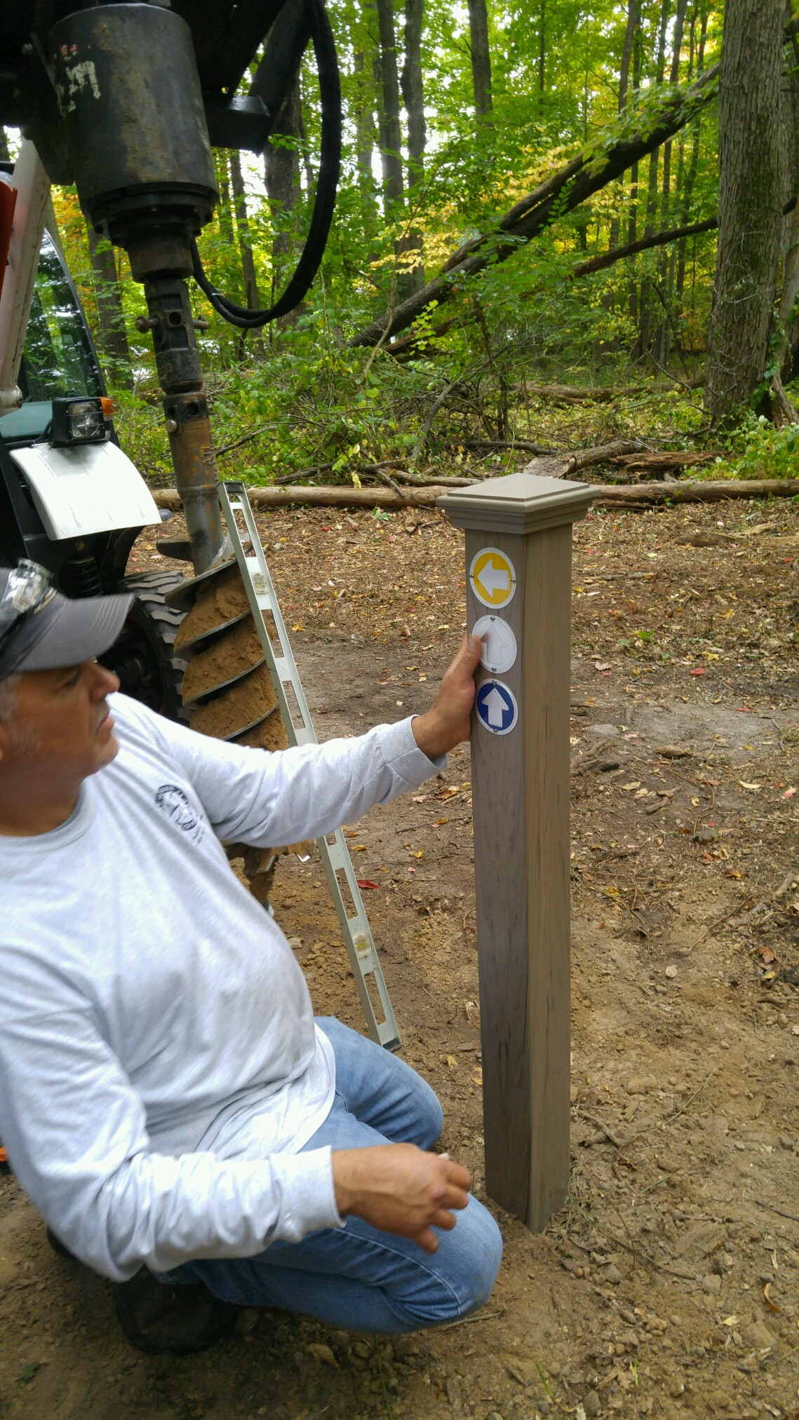 Public Works employees marking the new trail marker