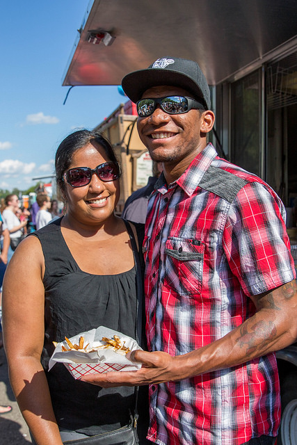 Couple with food at food truck rally
