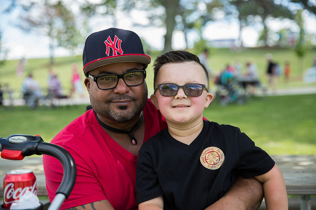 father and son at celebrate meridian event