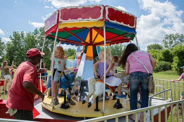 Kids riding carousel